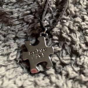 'Solve it' puzzle piece necklace